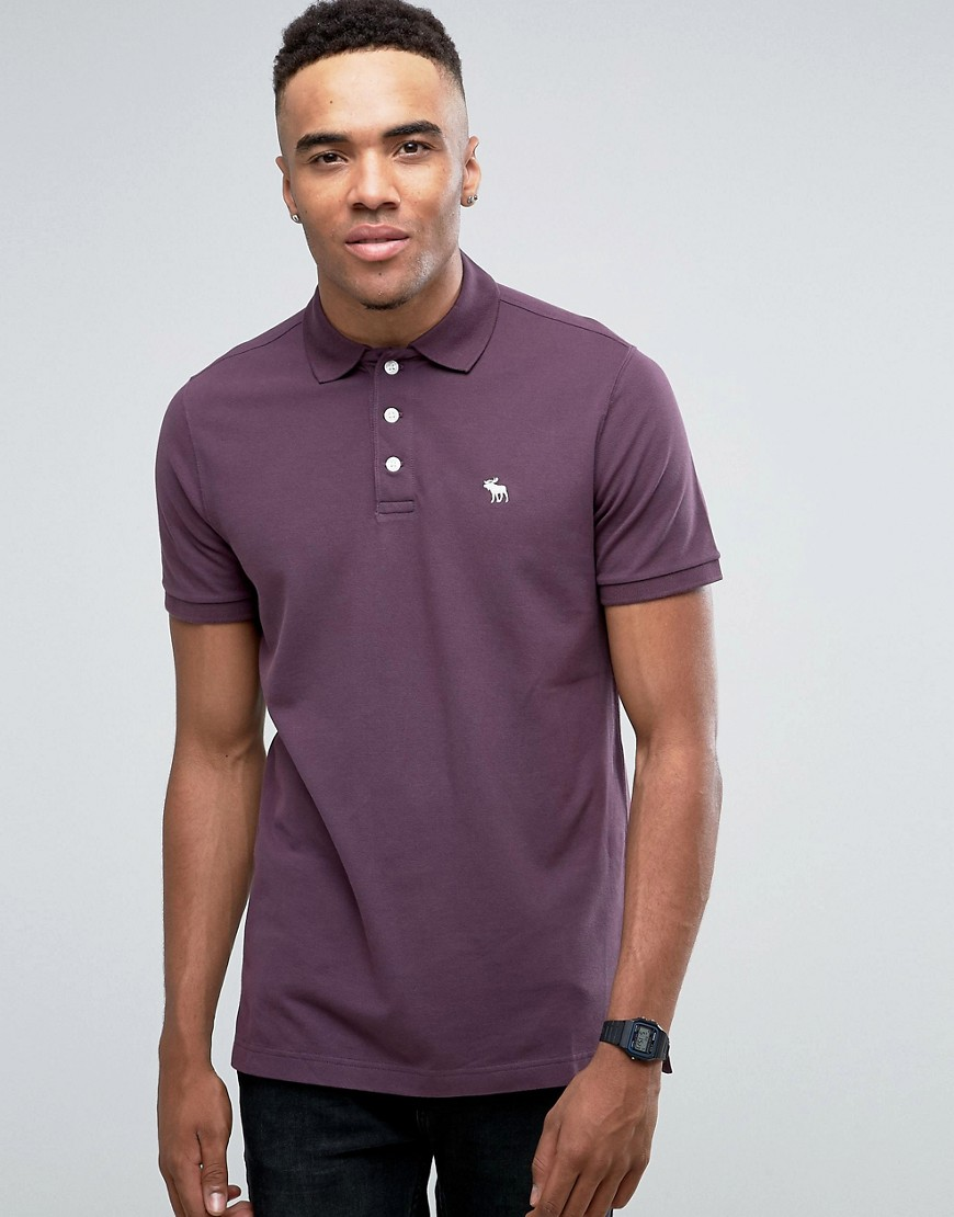Abercrombie & Fitch Pique Polo Stretch Slim Fit Icon Logo in Plum - Plum perfect