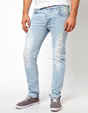 ASOS - Jeans slim candeggiati con strappi