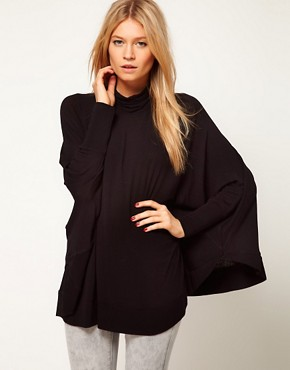 Image 1 ofASOS Top with Circle Roll Neck