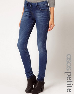 Image 1 ofASOS PETITE Supersoft High Waisted Ultra Skinny Jeans in Mid Stonewash