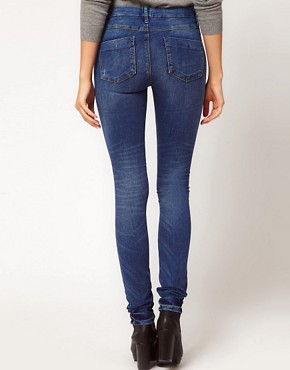 Image 2 ofASOS PETITE Supersoft High Waisted Ultra Skinny Jeans in Mid Stonewash