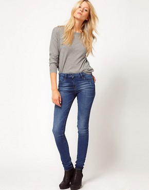 Image 4 ofASOS PETITE Supersoft High Waisted Ultra Skinny Jeans in Mid Stonewash