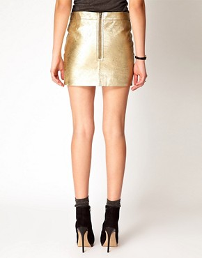 Image 2 ofGanni Leather Mini Skirt in Gold