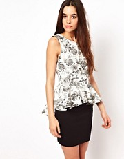 Club L Floral Dipped Hem Top