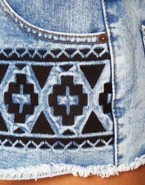 Image 3 ofASOS Vintage Denim Shorts with Embroidered Tribal Design