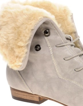 Image 2 ofRiver Island Turtle Faux Fur Lined Flat Boots