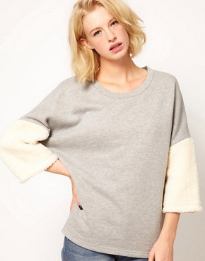 Image 1 ofASOS Sweatshirt with Fur Panel Sleeves