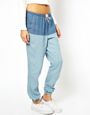 Image 1 ofASOS PETITE Exclusive Denim Look Trousers