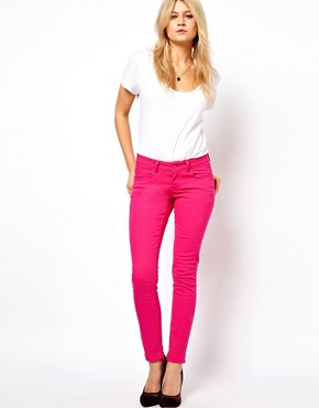 Image 4 ofASOS PETITE Exclusive Skinny Jeans In Pink