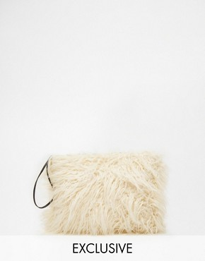 Story of Lola Faux Fur Clutch in Cream