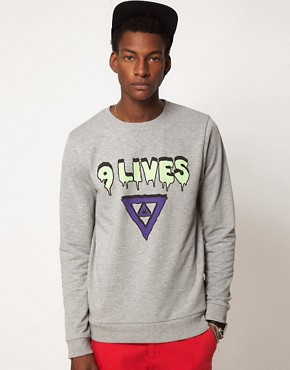 Image 1 ofASOS Sweatshirt With 9 Lives Print
