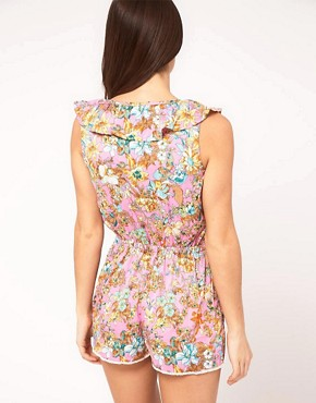 Image 2 ofRiver Island Pink Cut Out Front Floral Print Playsuit