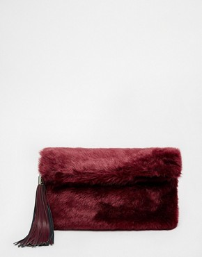 ASOS Faux Fur Roll Top Clutch Bag With Chunky Tassel