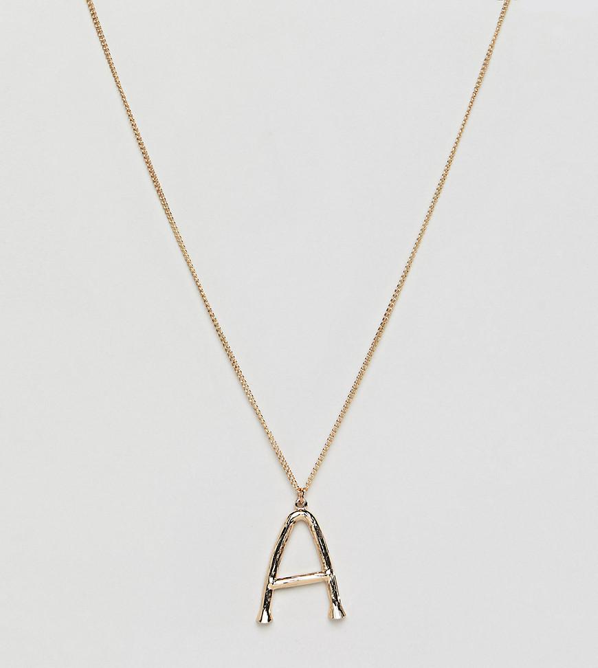 Золотистое ожерелье с подвеской в виде фактурной буквы А DesignB Londo DesignB London