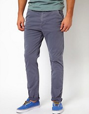 Chinos de corte slim color caqui de Nudie