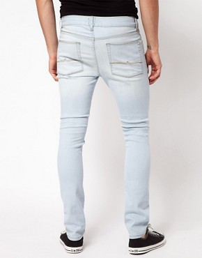 Image 2 ofASOS Super Skinny Jeans With Bleach Wash