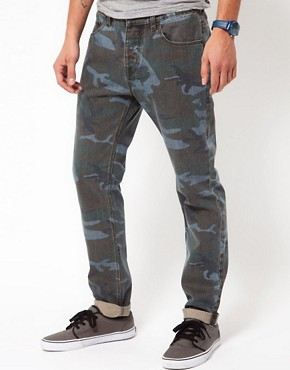 Image 1 ofASOS Slim Jeans in Washed Camo
