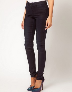 Image 1 ofASOS Coated Skinny Jeans in Washed Black