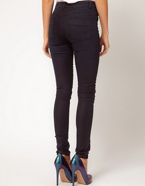 Image 2 ofASOS Coated Skinny Jeans in Washed Black