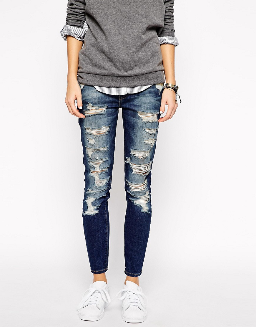 Product photo of Current elliott stiletto mid rise skinny jeans with all over rips distressing distressed blue
