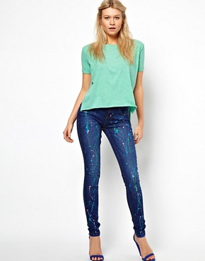 Image 4 ofASOS Vintage Wash Skinny Jean with Pretty Splatter Paint Effect