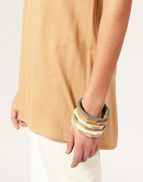 Image 2 ofASOS Pack Of Skinny Natural Stone Look Stacking Bangles