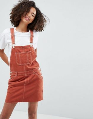 Image 1 of ASOS Denim Dungaree Dress in Rust