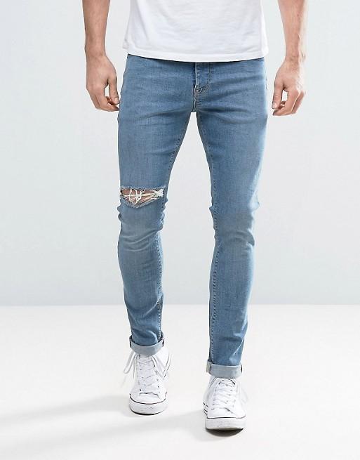 Jean super skinny avec déchirure sur la cuisse - Bleu moyen