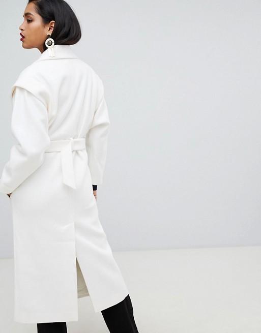 Manteau ceinturé style 80's à manches chauve-souris
