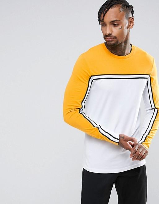 Inicio; Camiseta ajustada de manga larga con canesú y cinta en contraste de  ASOS. firstImage.AlternateText