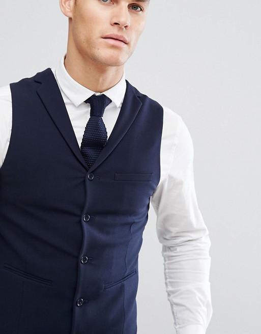 Chaleco de traje súper ajustado en azul marino de ASOS