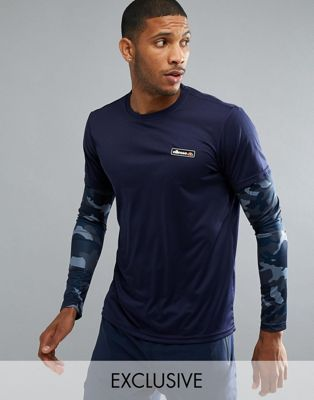 Image 1 of ellesse Sport Long Sleeve T-Shirt With Layered Sleeve In Navy