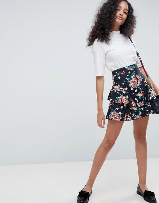 Minifalda con estampado de rosa y estrella de ASOS