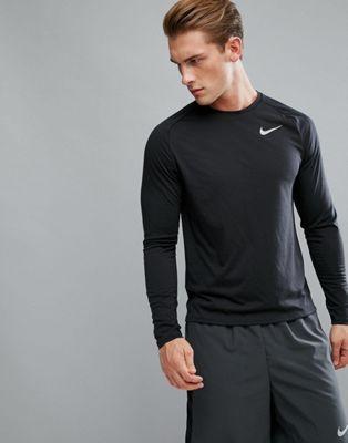 Image 1 of Nike Running breathe tailwind long sleeve top in black 921813-010