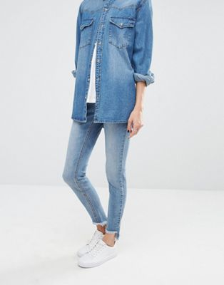 Image 1 of Noisy May Eve Low Rise Super Skinny Jeans with Uneven Raw Hem