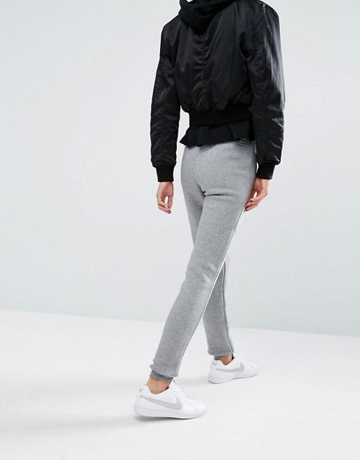 Pantalones de chándal de corte slim Rally de Nike
