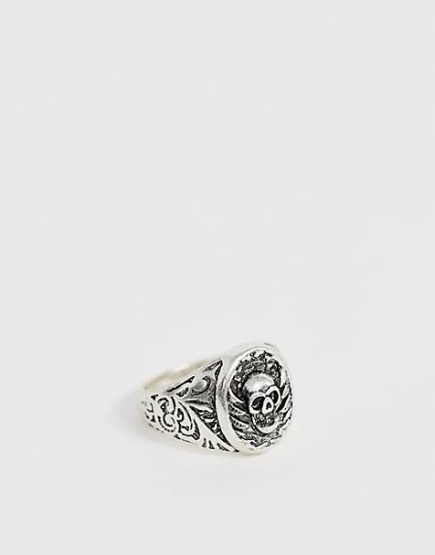 Reclaimed Vintage inspired signet ring with emboss and skull detail exclusive at ASOS