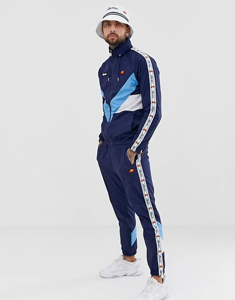 ellesse tracksuit with white taping in navy