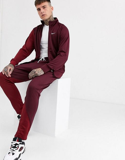 Nike – Trainingsanzug mit Reißverschluss und Logo in Burgunder/Rot