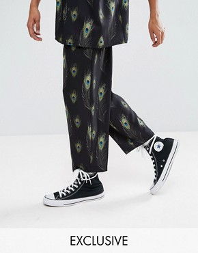 Reclaimed Vintage Inspired Relaxed Trousers In Black With Feather Print - Black