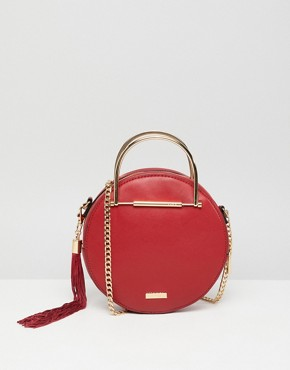 ALDO circle crossbody bag with gold top handle in red