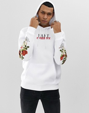 YOURTURN hoodie in white with rose print sleeves
