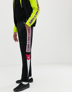Champion track joggers with taping in black