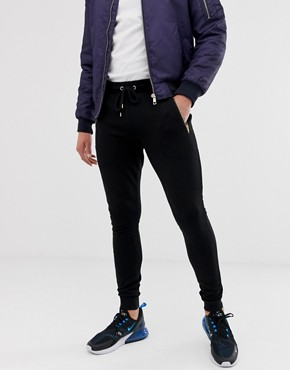 ASOS DESIGN super skinny joggers with gold zips in black