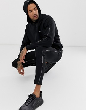 Good For Nothing joggers in black with logo side taping