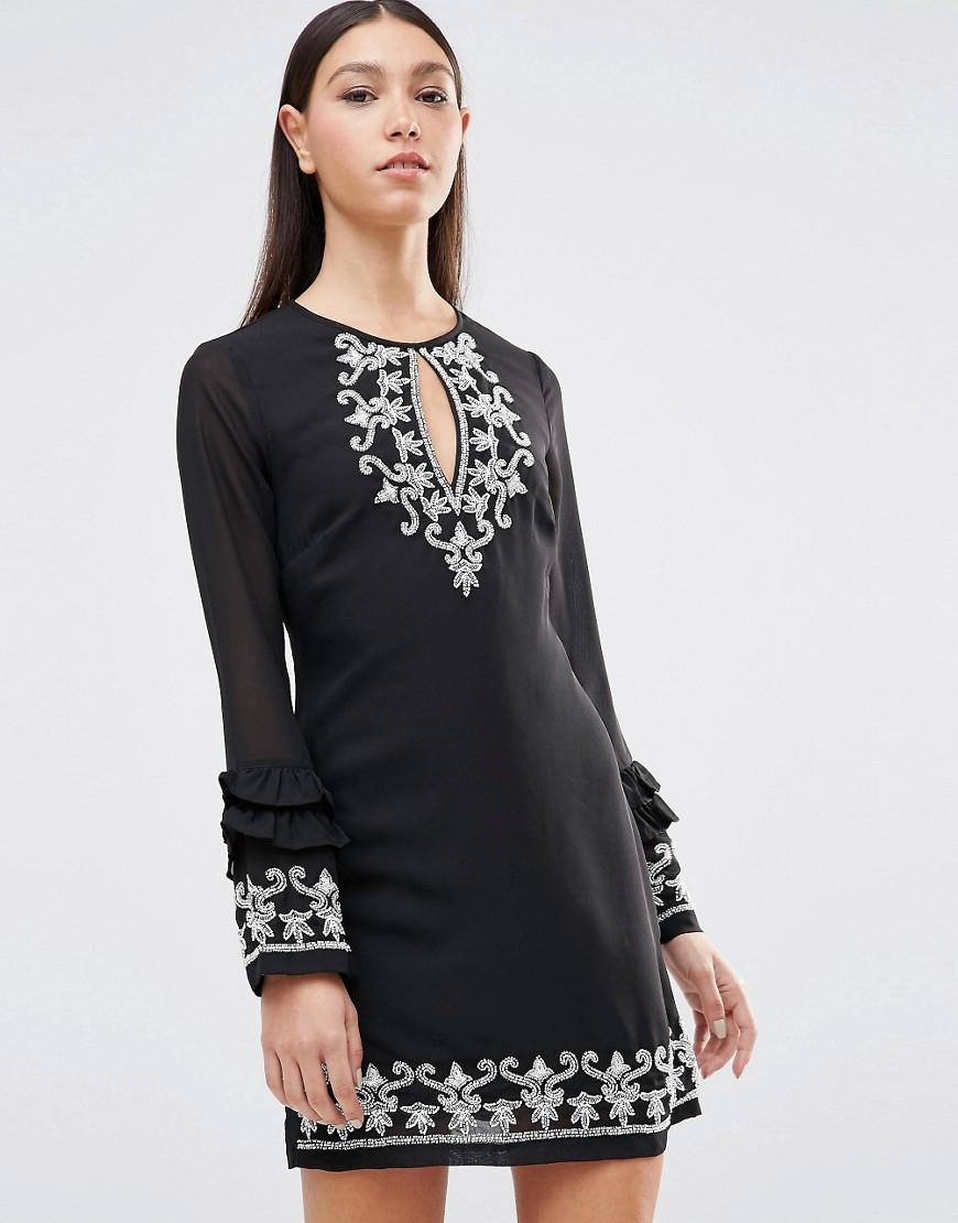 Maya Keyhole Front Ruffle Hem Long Sleeve Dress With Embriodered Detail
