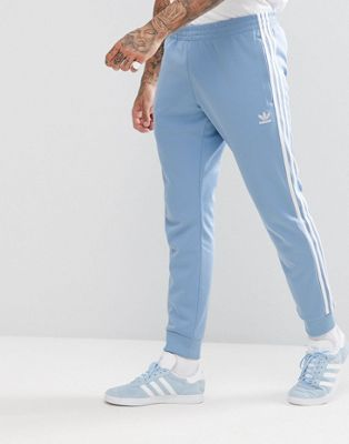 adidas Originals adicolor skinny Joggers cuffed hem In Blue CW1277