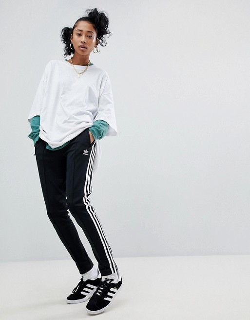 3b2dd30c40d adidas Originals adicolor three stripe track pants in black | ASOS
