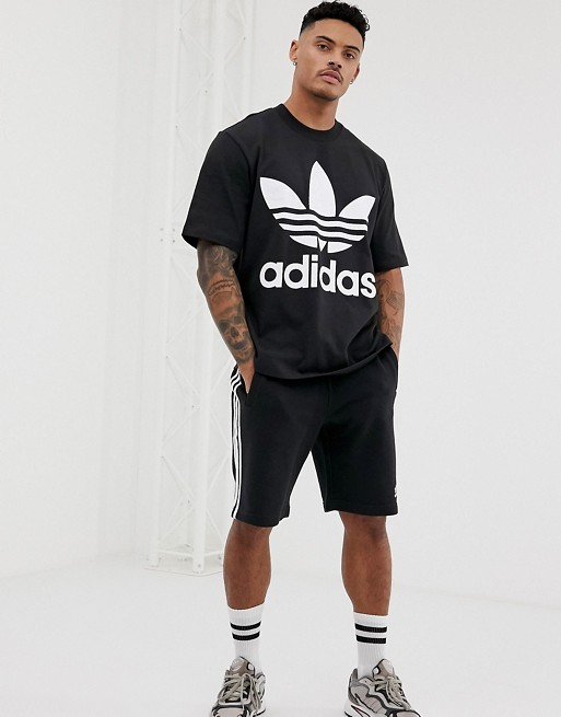 4e24dff822a7 Shoptagr | Adidas Originals Oversized Trefoil T Shirt In Black by ...