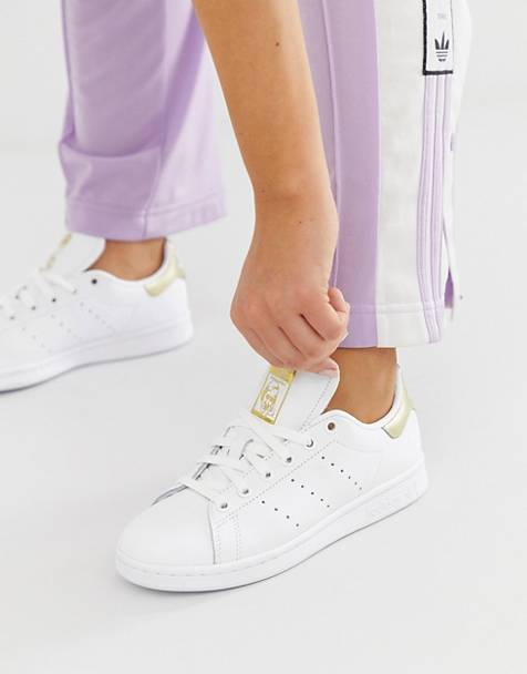 adidas Originals Stan Smith in white and metallic gold